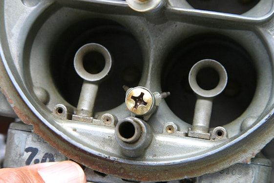 23 A close-up of a tube-type accelerator pump nozzle in the