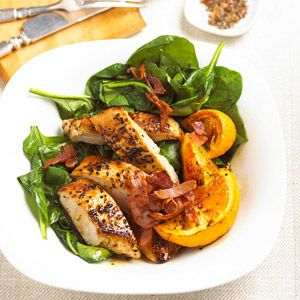 Oranges add a light citrusy touch to this seasoned turkey, ham, and spinach main-dish recipe prepared in less than 30 minutes./