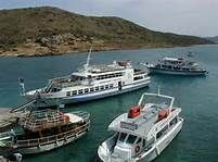 Boat from Elounda to Spinalona- who pays the Ferryman?