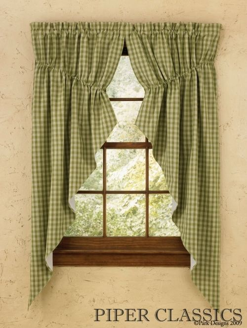 "<p>Sturbridge Pattern from Park Designs is perfect for decorating your country home. A traditional country plaid in warm leaf green and creamy beige. Coordinate with our Placemats and Runners.</p>  <p>Our Sturbridge Green Gathered Swag Pair by Park Designs creates a soft profile for the window with a draw string to make it adjustable to most window widths. Fully lined. 100% cotton. Dry cleaning recommended. 72"" wide x 63"" long.</p>  <p><a ..."