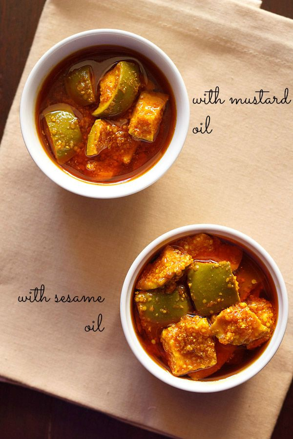 gujarati mango pickle or methia keri pickle recipe - spiced, sour mango pickle made with split fenugreek seeds and mustard seeds. step by step recipe.