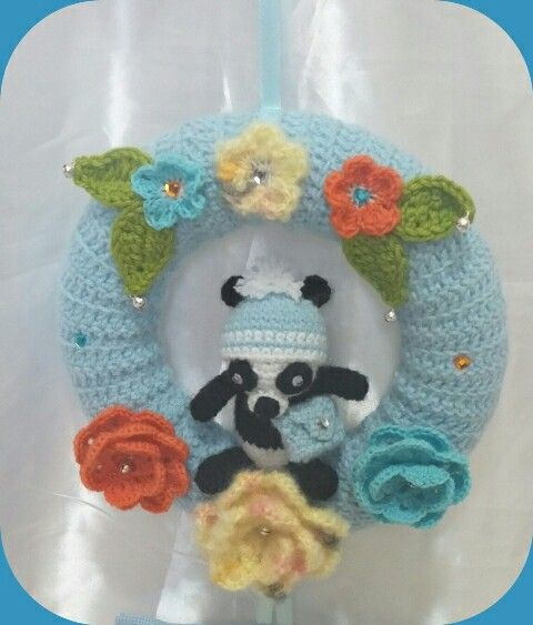 Bow made with three techniques. Crochet, amigurumi and cross stitch.