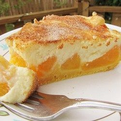 "Award Winning Peaches and Cream Pie | ""This recipe yields a fabulous 10-inch deep-dish pie with an unusual crust made with vanilla pudding, flour, milk, butter, and a bit of baking powder. Sliced peaches are spread over the crust and topped with a fluffy cream cheese layer. It 's then baked and chilled before serving."""