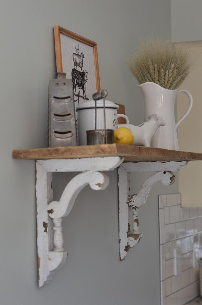Need a unique piece and love the rustic look? This adorable shelf is made from two things, old barn-wood and beautiful chippy white corbels. This is a statement piece in our kitchen!