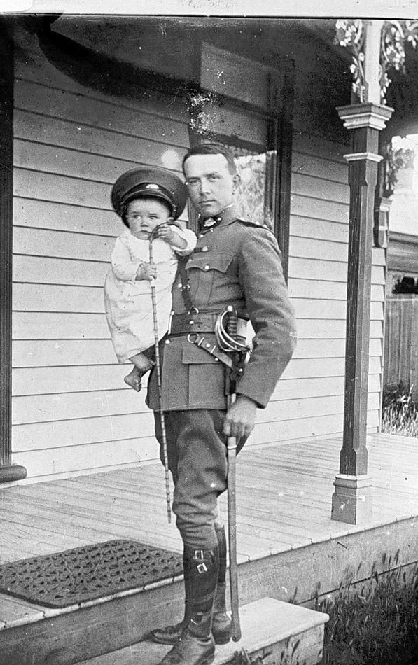 Otto Emil Müller (Miller) & his son Ralph in 1914 while Otto was serving as the Citizen Military Force Area Officer in Horsham. Otto was born in 1881 in Horsham to German born parents, he worked as a builder and contractor. In the Boer War he enlisted with the 5th Victorian Contingent. In 1912 he married Elsie Foster Fraser and in 1913 their son Ralph (the baby in the photograph) was born. Otto died in 1953. Horsham, Victoria, 1914 - Museum Victoria