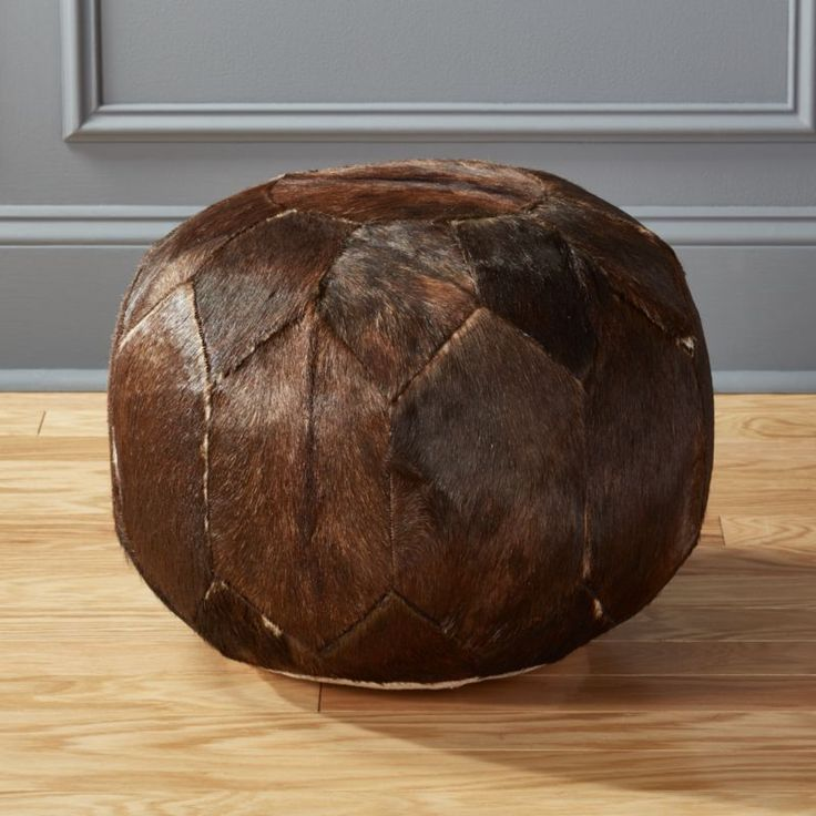 Shop Hide Pouf Brown.   Cowhide comes home in a patchwork Moroccan-style pouf. Hair-on-hides naturally vary in color, tone and spotting, so each will be unique.