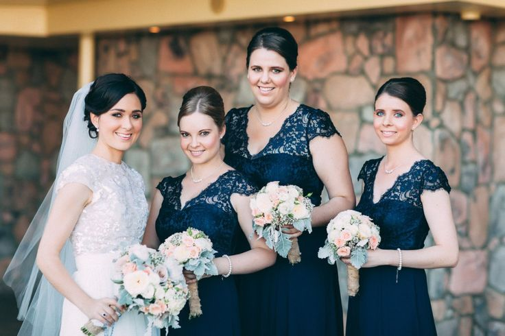 The Bride and her bridesmaids in Review navy bridesmaid dresses.