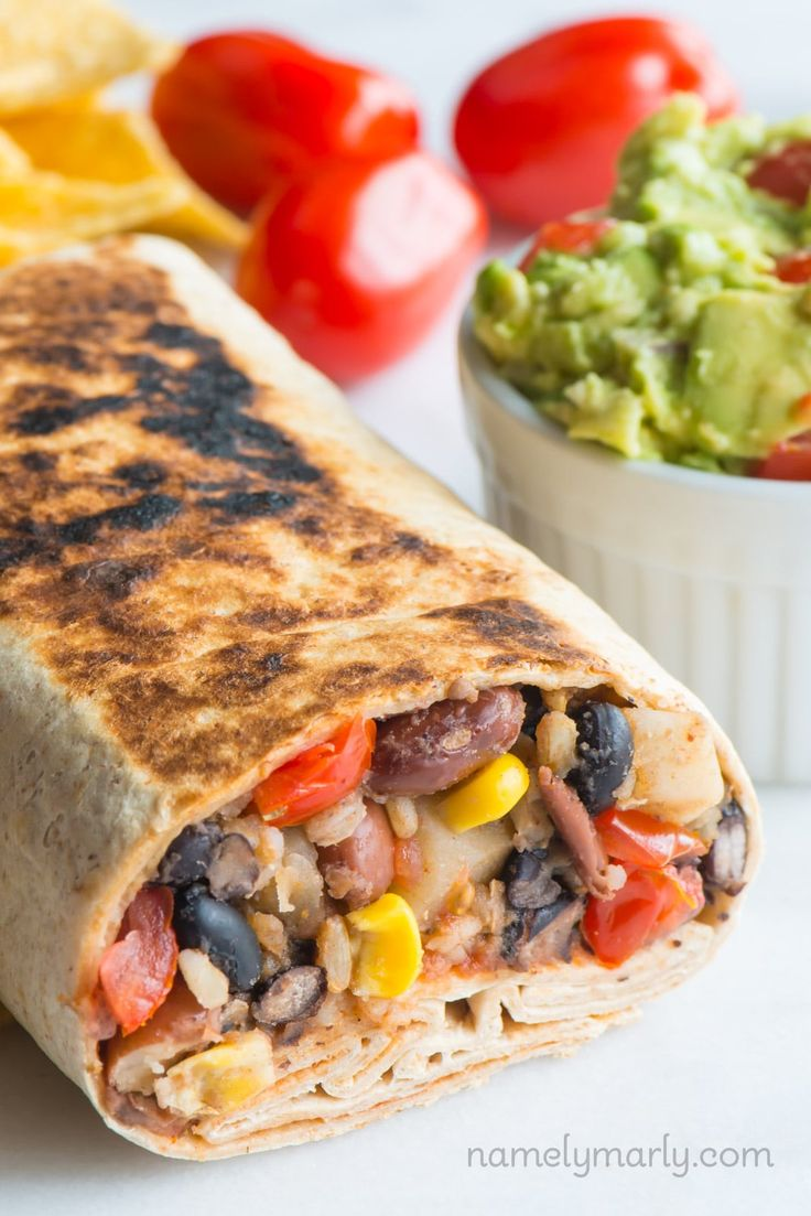 This easy Crispy Black Bean Burrito recipe is made with brown rice, potatoes, corn, and salsa. Served in a crispy burrito shell and topped with guacamole!