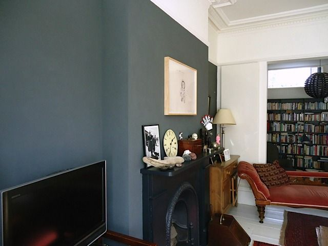 dark feature wall, all black fireplace, white woodwork