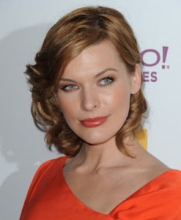 Milla Jovovich with light auburn hair - the orange really makes her blue eyes pop!
