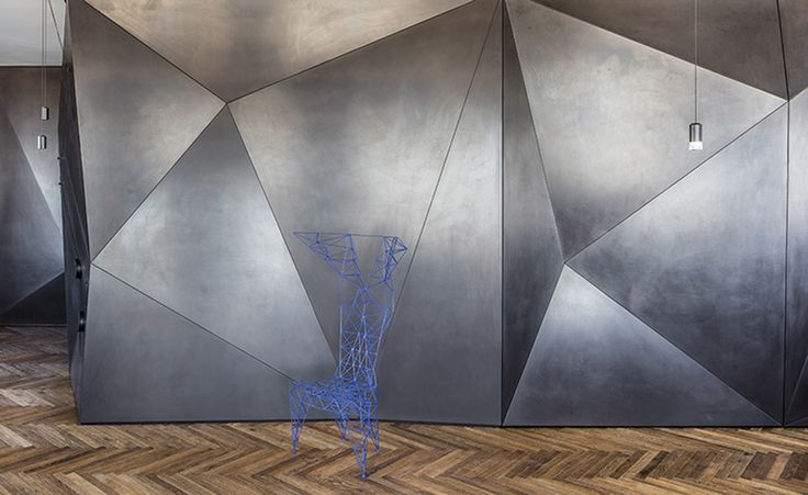 Israeli architecture firm Pitsou Kedem has taken their love of geometry to new heights in a private Tel Aviv penthouse featuring an innovative, multipurpose 'origami' wall. The sculpted, three-dimensional wall, made of folded iron, runs the length of t...