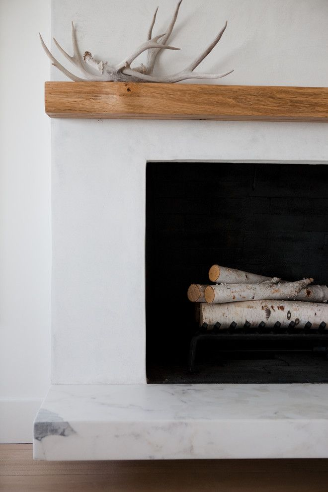 White Stucco Fireplace with Vintage Barn Wood Mantel and Floating Hearth. Wood/marble combo? Would prefer different wood to this.