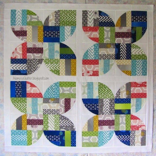The block pattern is http://sewkindofwonderful.blogspot.com/2014/05/spring-fling-freebie.html by Sew Kind of Wonderful. It is a free pattern and uses their Quick Curve Ruler.
