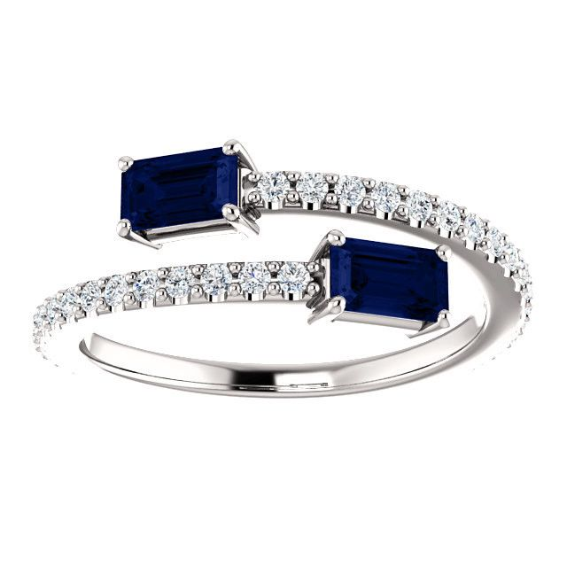 - AA sapphires - 5x3mm emerald cut, 1 ctw - 38 1mm diamonds, G, SI quality - 4.3 grams - New - Free shipping worldwide - Five year warranty This is a beautiful platinum two stone bypass ring with emer
