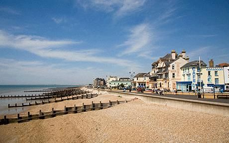 Bognor Regis England .  This is where I lived while doing my internship in 2002.  I used to run on this beach and saw Eric Clapton and his wife and child one day while I was running!