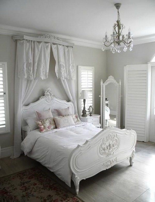 White in White Shabby Chic Bedroom with a Canopy over Headboard.                                                                                                                                                                                 More