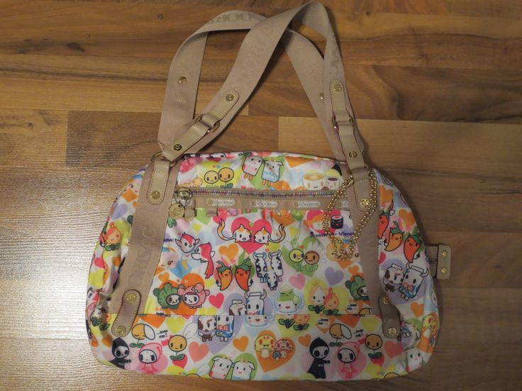 TRADED ON FACEBOOK Tokidoki lesportsac l'amore gioco purse for sale, no qee, contact for more pics to see stains.  Leather looks great.  $125, might consider trading for the right bag in inferno or foresta print.