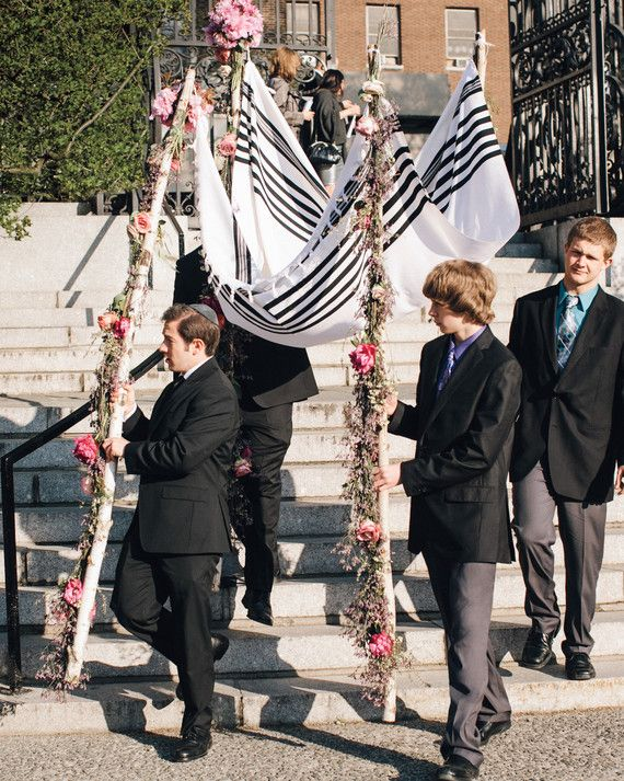 Lisa and Eric's cousins carried this chuppah, with flowers embellishing the four poles, at their spring wedding at Central Park's Conservatory Garden.