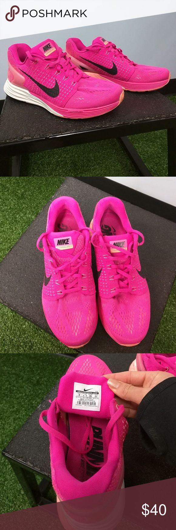 Nike Lunarglide 7 running sneakers Gently used (5 times) Cleaned and has LOTS of life left. My profession allows me to collect many shoes...trying to declutter my stash.   Fabulous color! Neon Pink with mango accents.  Bundle for extra discount Nike Shoes Athletic Shoes