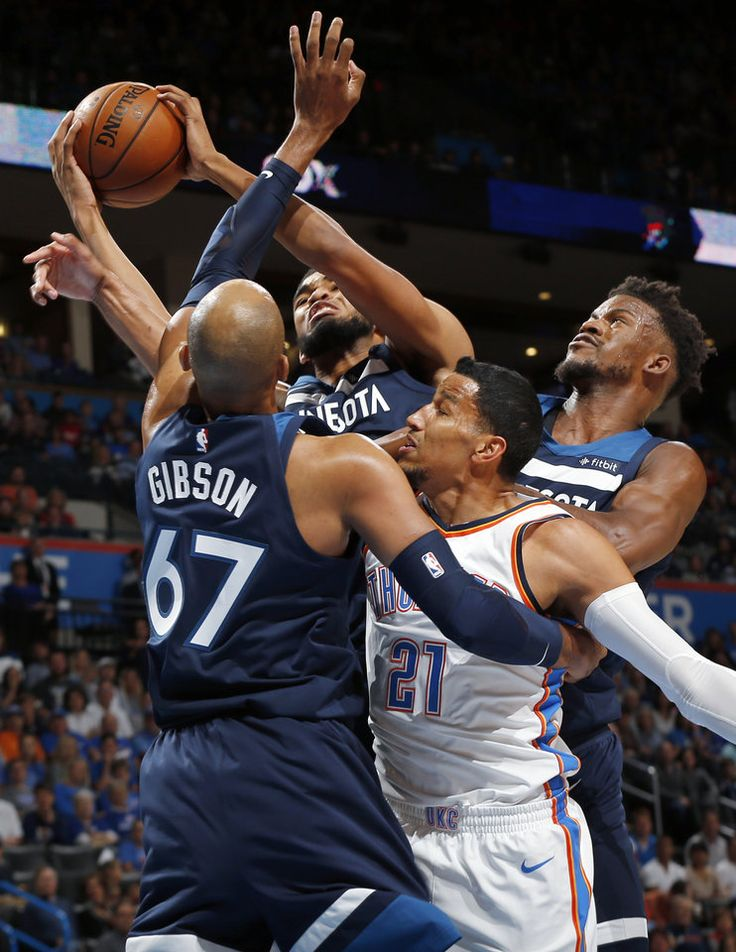 Minnesota's Karl-Anthony Towns (32) grabs a rebound next to Taj Gibson (67), Jimmy Butler (23) and Oklahoma City's Andre Roberson (21) during an NBA basketball game between the Oklahoma City Thunder and the Minnesota Timberwolves at Chesapeake Energy Arena in Oklahoma City, Sunday, Oct. 22, 2017. Photo by Nate Billings, The Oklahoman