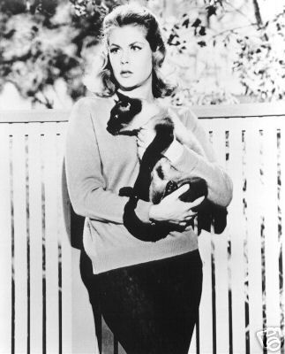 Elizabeth Montgomery with her Siamese cat