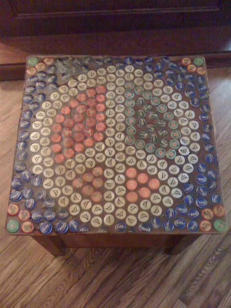 A table @Jordan Kingsley and I made with beer bottle tops sealed with resin! Lots of work but worth it in the end!