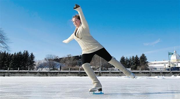 Falon Milligan, a University of Ottawa student, figure skating on the Rideau Canal.  Photograph by Wayne Cuddington