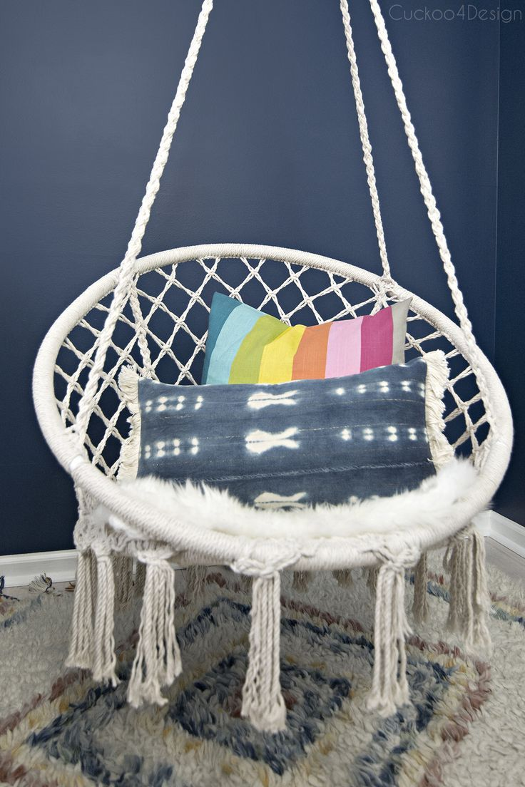 hanging macrame hammock chair for a girl's bedroom | girls bedroom with dark blue walls and a hanging macrame hammock chair via @jakonya