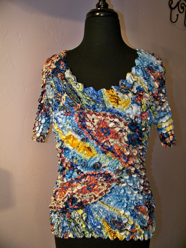 Magic Top -- Adds pizzazz to any outfit.  Comfortable fabric expands and contracts to fit any figure!
