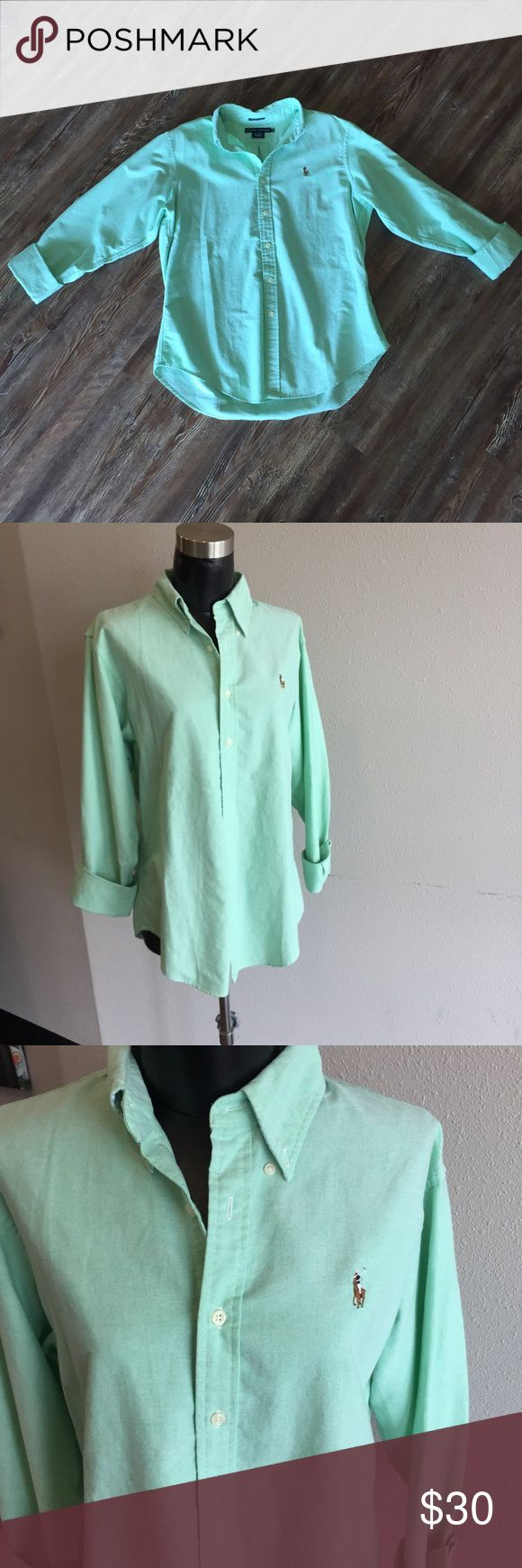 Women's Ralph Lauren Oxford Classic Fit. Size 14 •button down collar, long sleeves, barrel cuffs. •100% cotton •signature multicolored embroidered pony accents the left chest. This shirt is in GREAT condition. Like new. (705) ••shirt is a mint green color Ralph Lauren Tops Button Down Shirts