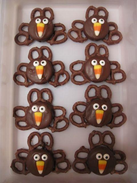 Turkey Treats | Dip Oreos in melted chocolate, add eyes (Wilton Candy eyes) and candy corn beak with frosting. Place on chocolate frosted chocolate preztels.