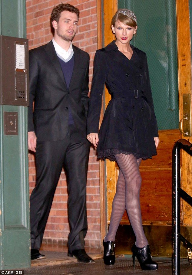 Taylor Swift showed off her legs in sheer stockings and a very short belted trench on Monday in the Big Apple