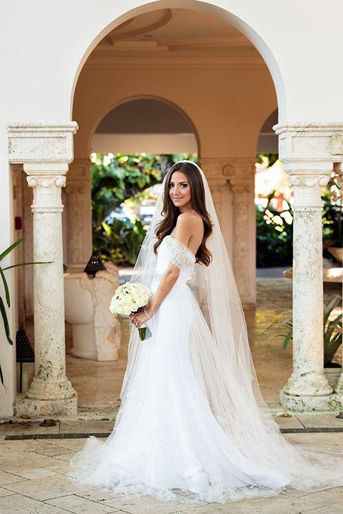 @ariellenachmani is a beautiful bride in a custom @csiriano wedding dress   @fredmarcus   Brides.com