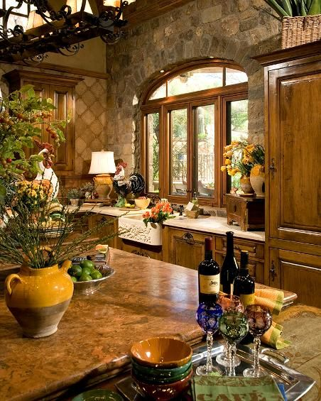 ...stonework and tile in the kitchen. Give it a Tuscan look that's simply GORGEOUS. But I'd want different cabinets.