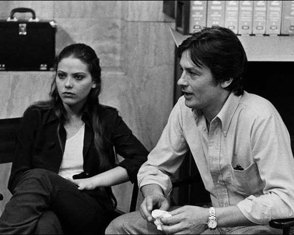 Alain Delon on the set of Mort d'un pourri; with Ornella Muti