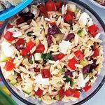 This salad highlights many fresh flavours of the Mediterranean and is at its best when made with good-quality olive oil. To pit several olives at once, place them on a cutting board and lightly crush with the bottom of a small saucepan to expose pits befo