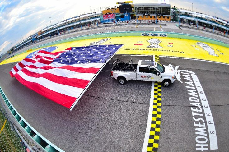 Ford breaks Chevrolet's record for pulling the largest flag in the world