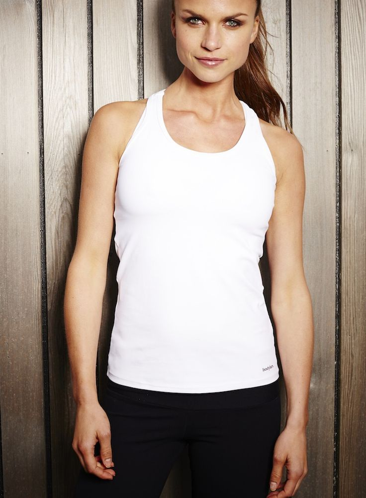 Florence Top Available in Black or White. A Bodyism hero product, the Florence Top is a scoop neck, slim-fit vest in quick-drying, sweat-wicking fabric, it is ideal for any workout. Featuring wider straps for added support and a tapered waist so that it stays put during exercise, this makes for the most comfortable sports vest yet.  Available now, £58.00 at http://www.bodyism.com/product/florence-top/