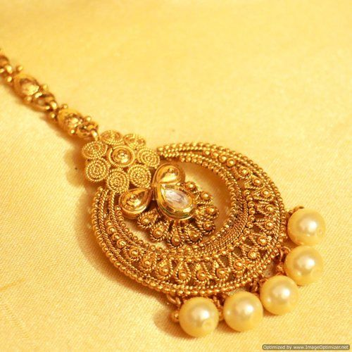 Shop Gold Look Kundan & Pearl Maang Tikka by Sanvi Jewels Pvt. Ltd. online. Largest collection of Latest Maang Tikkas online. ✻ 100% Genuine Products ✻ Easy Returns ✻ Timely Delivery