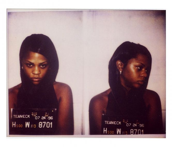 Lil Kim (aka Kimberly Jones) was arrested by New Jersey cops in July 1996 and charged with possession of marijuana. The rapper was rounded up after a police raid on the Teaneck home of Biggie Smalls (aka Christopher Wallace), her rap rabbi.