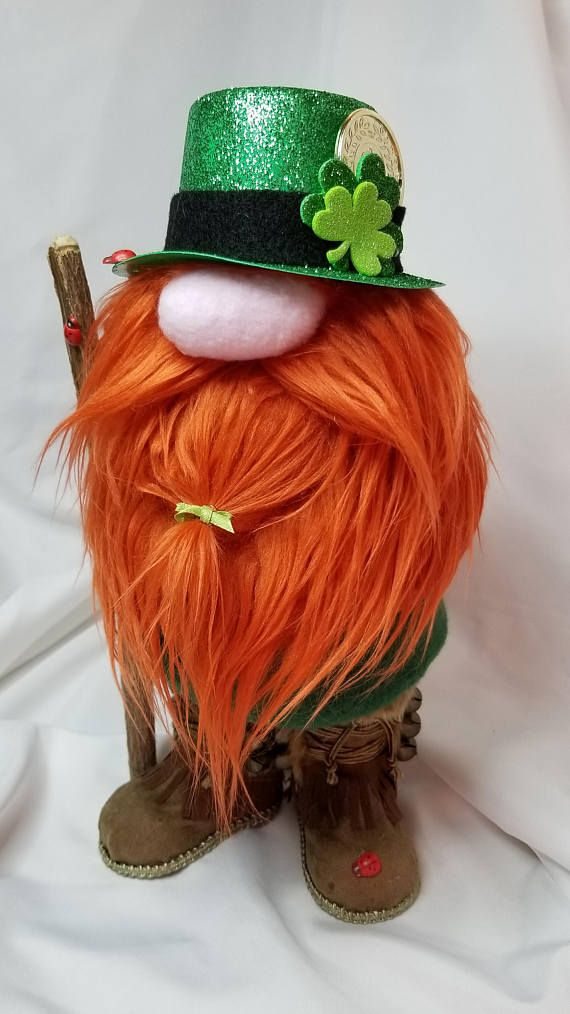 The luck O the Irish be with you! Lollan is outfitted with beautiful suede boots and his walking staff, he even has lucky lady bugs to keep him company on his journey. A very special leprechaun indeed! Lolan stands 11 inches tall and is handmade with all new materials including felt,
