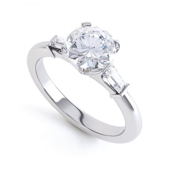 ND1018 - Solitaire with Tapered Baguettes. A beautiful three stone diamond ring set with a round brilliant cut centre stone and two matching baguette side stones, mounted on a tapered shank.
