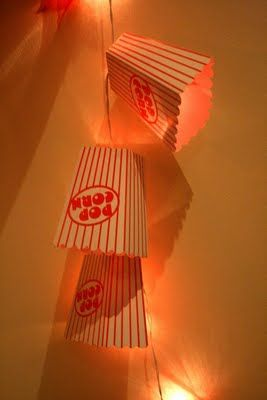 DIY for movie or circus themed party? Find those lightweight cardboard popcorn bags, and add them to string lights (preferably LED since they generate very little heat). Shop LED string lights online at http://www.partylights.com/LED/LED-String-Lights.