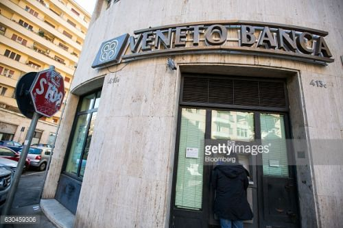 A customer uses an automated teller machine (ATM) at a Veneto... #moglianoveneto: A customer uses an automated teller… #moglianoveneto