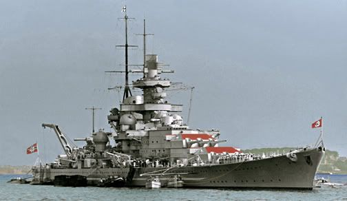 Often reported to be Scharnhorst, this is in fact her sister Gneisenau: after reconstruction with raked 'Atlantic' bows and funnel caps (as here), Scharnhorst's mainmast was shipped much further aft, whilst Gneisenau's remained adjacent to her funnel. Critically damaged by RAF bombing shortly after the famous 1942 'Channel Dash', she never went to sea again.