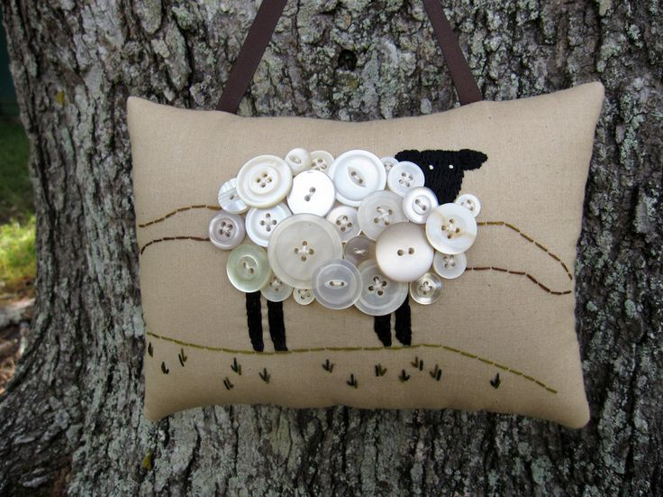 Sheep Embroidery Pillow--what a clever use of buttons! Cute sewing room decor . . . she also does a version with black buttons