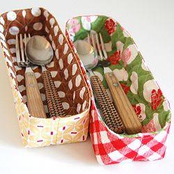 These fabric baskets are so cute! Use for holding forks and spoons at bbq and stuff.
