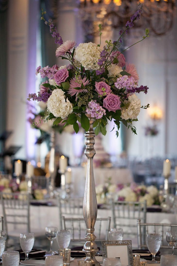 Tall purple and white floral centerpiece