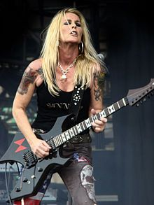 Lita Ford - hard rocking lead guitarist for mid-seventies all female rock group, the Runaways. Followed with long-term success as a solo artist.
