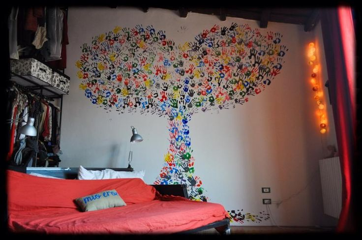 A big hand Made tree is now decorating our bedroom ... We loved the idea of having all our daughters together in this great colorful family tree#hand#family#print#wallpainting